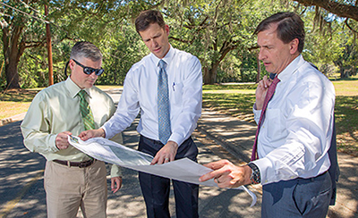 Kevin Graham, center, goes over expansion plans with FSU Associate General Counsel Dustin Dailey, left, and FSU Vice President for University Advancement Tom Jennings.