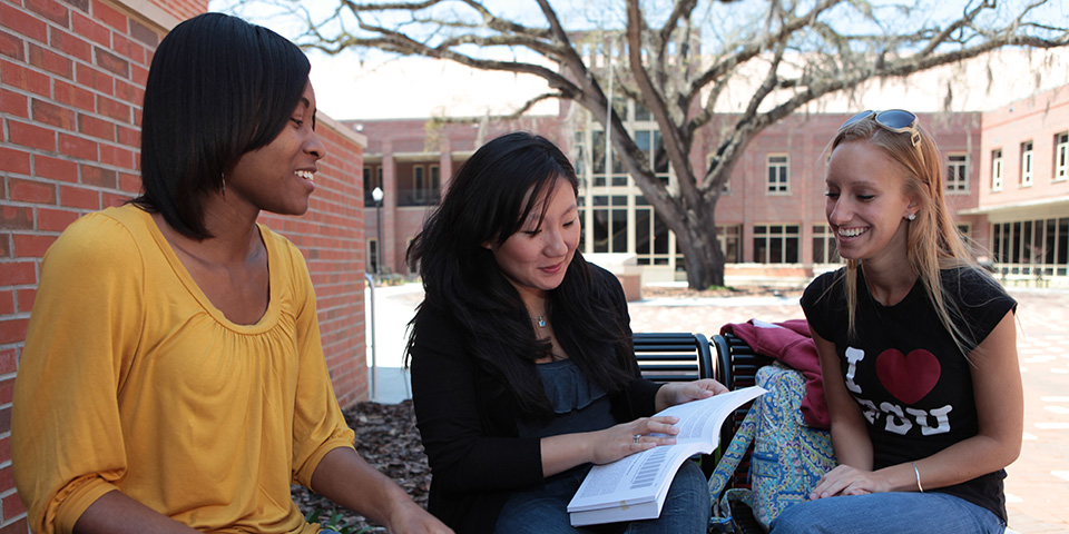 students smiling and studying