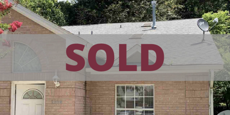 Brick condo with sold sign on top